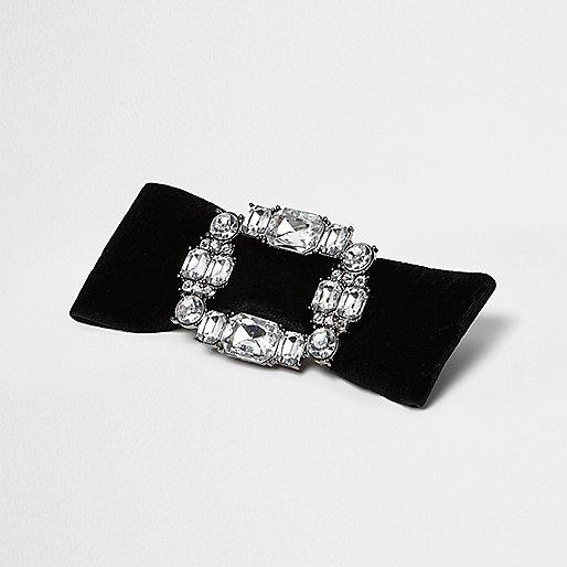 Zwarte broche met strik, diamantjes en gesp