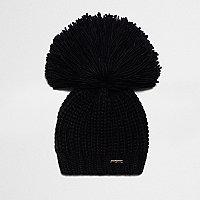Black oversized pom pom beanie hat