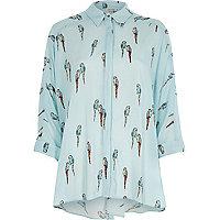 Chemise oversize imprimé perroquet bleue nouée au dos