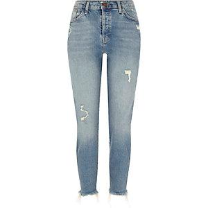 Mittelblaue, schmale Jeans mit Fransensaum im Used Look