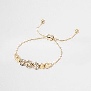 Bracelet lasso doré à perles et strass