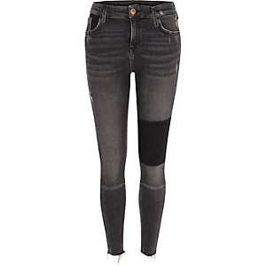 Amelie - Zwarte washed superskinny jeans met panelen