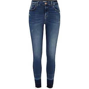 Amelie - Blauwe superskinny jeans met losgewerkte zoom