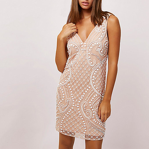 Light beige beaded sleeveless swing dress