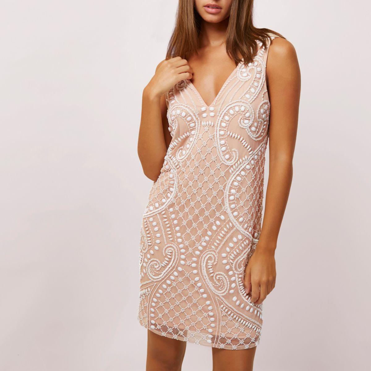 Light beige beaded sleeveless swing dress