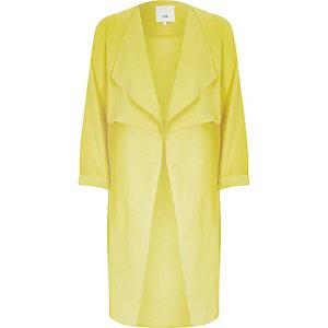 Veste longue jaune avec empiècement transparent