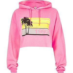 Sweat à capuche court imprimé palmier rose