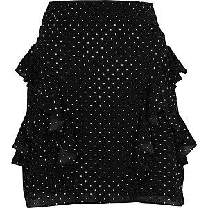 Mini-jupe noire à pois et volants
