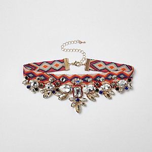 Collier ras-de-cou orange à motif aztèque orné de pierres