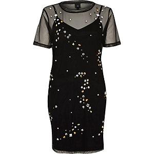Schwarzes T-Shirt-Kleid mit Verzierung