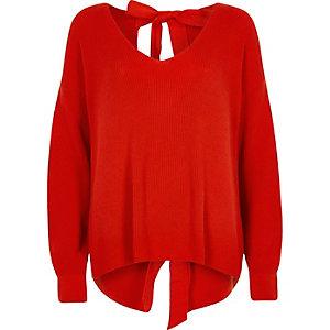 Rode pullover met strikken op de rug