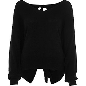 Zwarte gebreide pullover met lange mouwen en strik op de rug