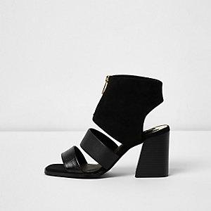 Schwarze Stiefel mit Reißverschluss und offener Zehenpartie
