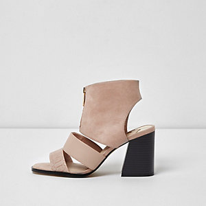 Light pink zip front block heel shoe boots