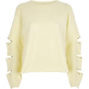 Hellgelbes Sweatshirt mit geschlitzten Ärmeln