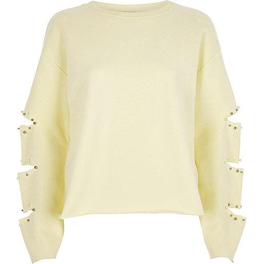 Light yellow slashed sleeve sweatshirt
