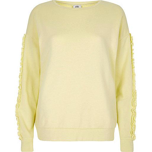 Light yellow frill sleeve sweatshirt