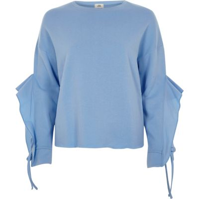 Blauw sweatshirt met ruches aan de mouwen