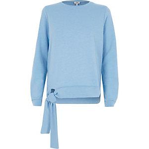 Lichtblauw sweatshirt met strik aan de zoom