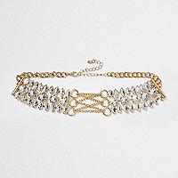 Goudkleurige chokerketting met corsetdetail en diamantjes
