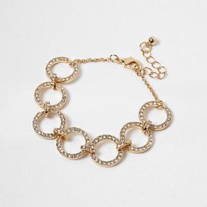 Bracelet doré avec breloque circulaire à strass