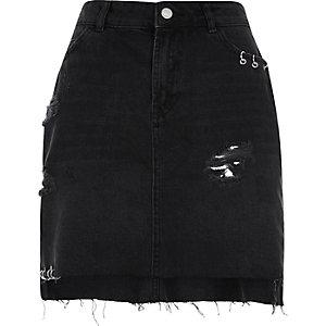 Zwarte ripped denim rok met oogjes