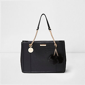Black pom pom chain handle tote bag