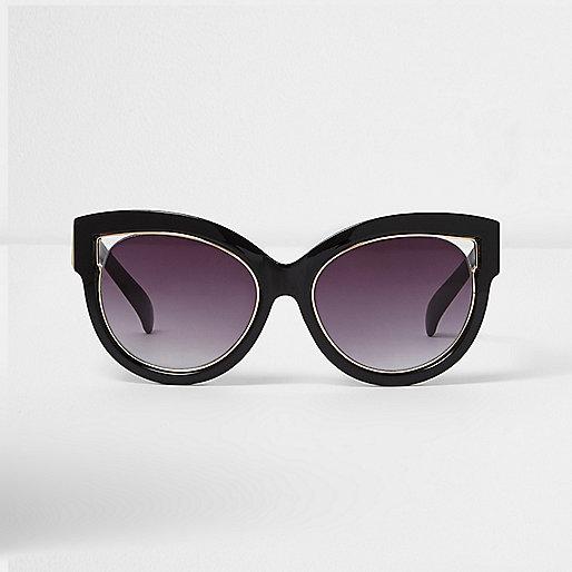 Zwarte cat-eye-zonnebril met goudkleurige rand en uitsnede