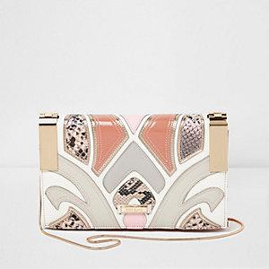 Pink cutabout snakeskin crossbody clutch bag