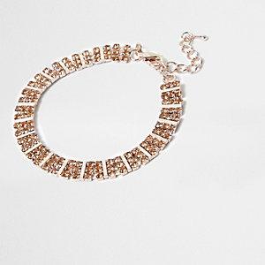 Bracelet façon or rose à carrés ornés de strass