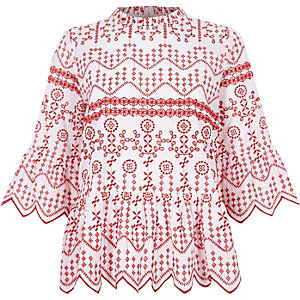 Red embroidered cutaway hem smock top