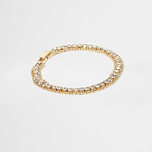 Gold tone rhinestone encrusted tennis bracelet