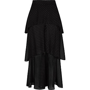 Pantalon en mousseline noire à pois et volants