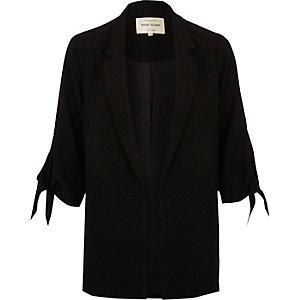 Zwarte blazer met strik op de mouw