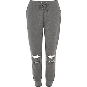 Pantalon de jogging gris déchiré orné de perles
