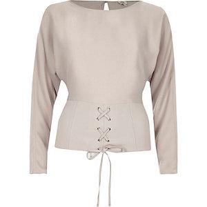 Lichtgrijze top met lange mouwen en corsetdetail voor