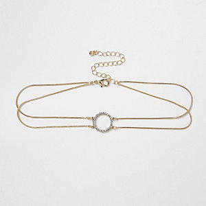 Goudkleurige chokerketting met cirkel bezet met diamantjes
