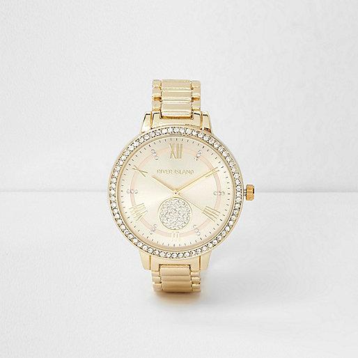 Gold tone diamante round face watch