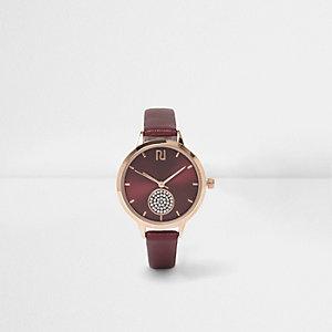 Rote, runde Armbanduhr mit Schmucksteinen