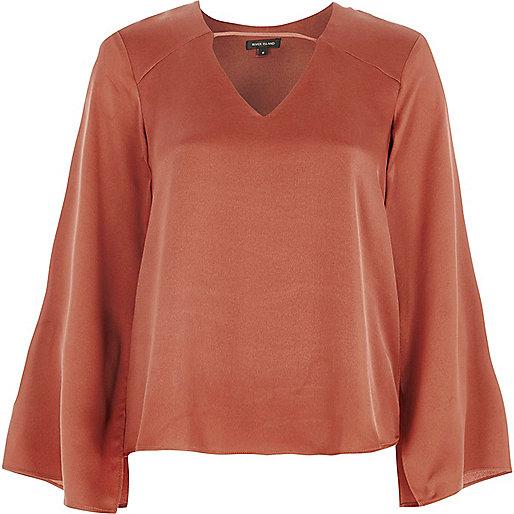 Copper orange twist back long sleeve top