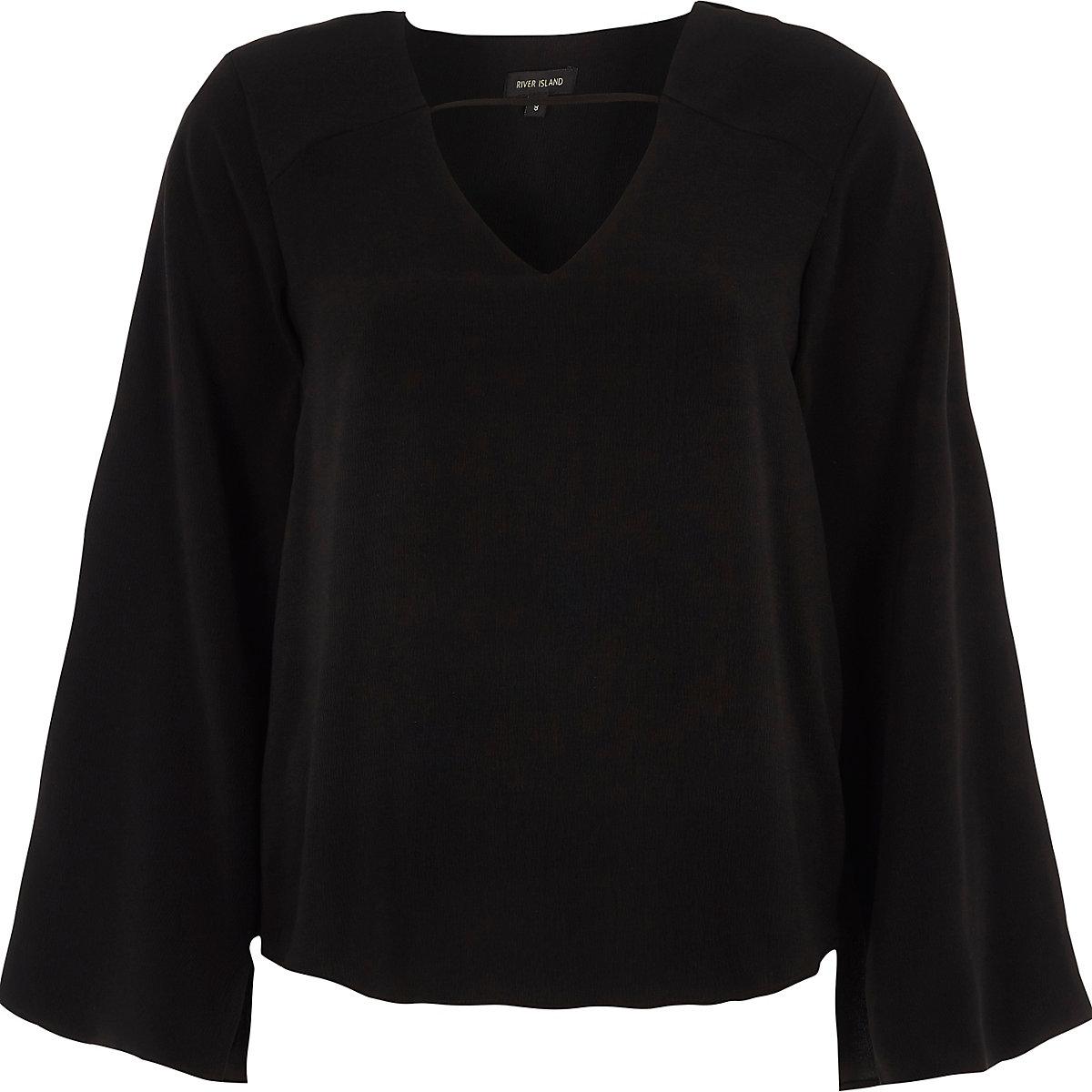 Zwarte top met lange mouwen en gedraaide achterzijde