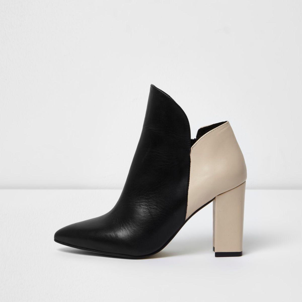 Beige and black block heel boots