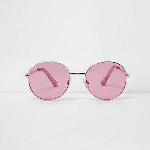 Goldene, runde Sonnenbrille mit pinken Gläsern
