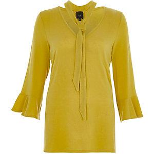 Pull jaune citron avec manches à volants et liens à nouer à l'encolure