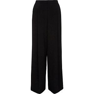 Zwarte broek met wijde pijpen