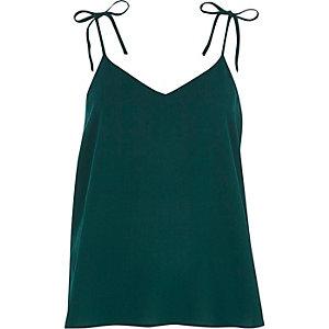 Blauwgroene camitop met textuur en strikje op de schouders