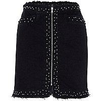 Jupe en jean noire cloutée effilochée zippée sur le devant
