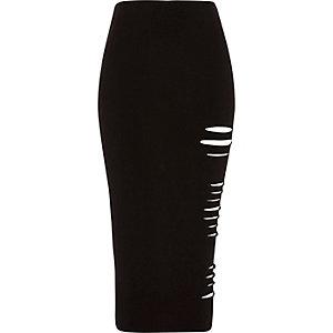 Jupe mi-longue en jersey noire moulante à découpes