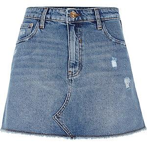 Mini-jupe en jean bleu moyen usé