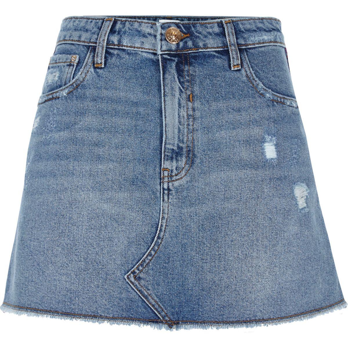 Mid blue denim distressed mini skirt